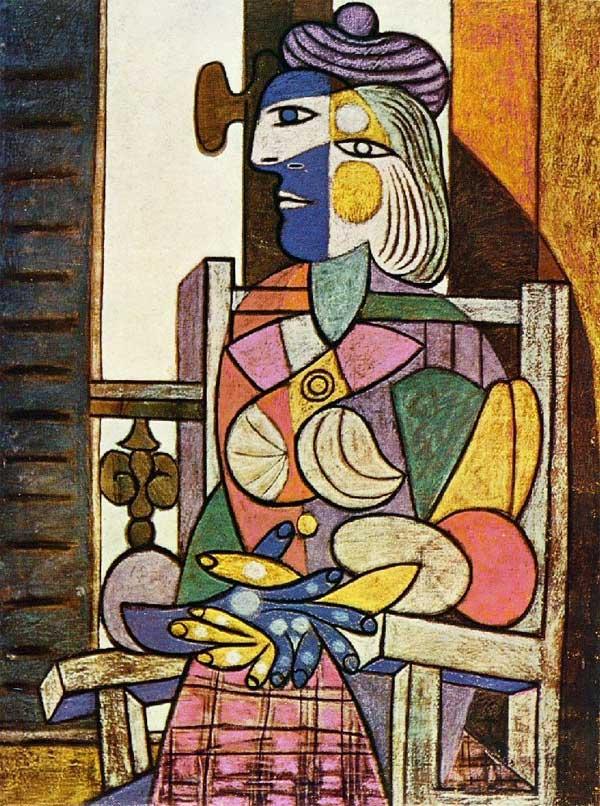 Femme-assise-devant-la-fenetre